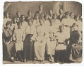 View Photographic print of a group of young men and women standing in 3 rows digital asset number 0