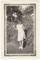 View Photographic print of a woman posing in front of bushes digital asset number 0