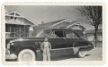 View Photographic print of young boy standing in front of a car digital asset number 0