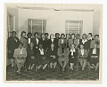 View Photographic print of three rows of women in a room digital asset number 1