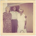 View Chromogenic print of a man standing with his arms around two ladies digital asset number 0