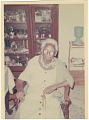 View Chromogenic print of an elderly woman sitting in a chair digital asset number 0