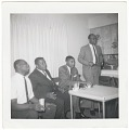 View Photographic print of four men sitting around a table digital asset number 0