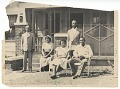View Photographic print of 3 men and 2 women sitting in front of Jack's Memory Chapel digital asset number 0