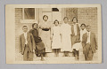 View Photographic print of 8 people in front of a building digital asset number 0
