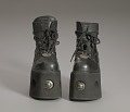 View Black platform ankle boots worn by Bootsy Collins digital asset number 9