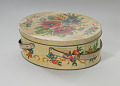 View Floral print tin containing feathers and faux flowers from Mae's Millinery Shop digital asset number 0