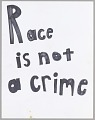 "View Poster reading ""Race is not a crime"" used at Baltimore protests digital asset number 0"