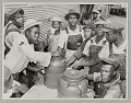 View <I>WASECA – BARBADOS ISLAND STORY: FILLING UP COFFEE CUPS AT THE COFFEE URNS AT THE END OF CHOW LINE</I> digital asset number 0