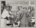 View <I>WASECA – BARBADOS ISLAND STORY: FILLING CUPS AT COFFEE URN AT END OF CHOW LINE</I> digital asset number 0