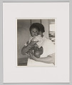 View Portrait of an unidentified cafeteria worker and unidentified baby digital asset number 0
