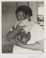 View Portrait of an unidentified cafeteria worker and unidentified baby digital asset number 2