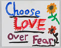 """View Sign with """"Choose Love over Fear"""" used in the Unite the Right counter-protest digital asset number 0"""