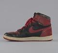 View Pair of red and black Air Jordan I high top sneakers made by Nike digital asset number 7