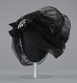View Black cap with netted lace and silver flower brooch from Mae's Millinery Shop digital asset number 2