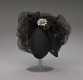 View Black cap with netted lace and silver flower brooch from Mae's Millinery Shop digital asset number 0