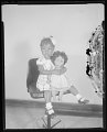 View Studio portrait of a young girl with a doll digital asset number 1
