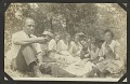 View Photo of a group of people having a picnic digital asset number 0