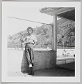 View Photographic print of an unidentified woman posed in front of a pool digital asset number 0