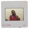 View Photographic slide of activist Joe Beam sitting against a white wall digital asset number 1