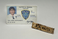 View 9/11 Port Authority Police Name Tag digital asset: Identification card and name tag, worn by Port Authority Police Department Captain Kathy Mazza Delosh on September 11, 2001.