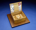 View Sample of Plutonium-239 digital asset: Sample of plutonium-239 in cigar box.  Overall view, box open.