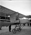 View [Early airplane (biplane) near hangar] : stereo photonegative digital asset: [Early airplane (biplane) near hangar] : stereo photonegative, 1908.