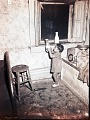 View [Little girl taking bottle from windowsill, photonegative.] digital asset: [Little girl taking bottle from windowsill, photonegative.]