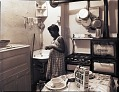 View [Girl brushing her teeth in kitchen : photonegatives.] digital asset number 0