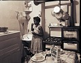 View [Girl brushing her teeth in kitchen : photonegatives.] digital asset number 1
