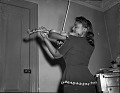 View Young woman playing violin : cellulose acetate photonegative] digital asset: Young woman playing violin : cellulose acetate photonegative].