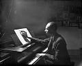 View [Thomas Kerr at piano : black-and-white photonegative.] digital asset: [Thomas Kerr at piano : black-and-white photonegative.]