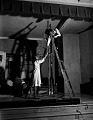 View [Man, woman, and ladder on stage, Howard University : black-and-white cellulose acetate photonegative.] digital asset: [Man, woman, and ladder on stage, Howard University : black-and-white cellulose acetate photonegative.]