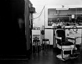 View Ewell's Barber Shop [interior with chair] [black-and-white photonegative] digital asset: Ewell's Barber Shop [interior with chair] [black-and-white photonegative]..