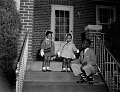 View [Three well-dressed children on steps, April 28, 1955.] digital asset: [Three well-dressed children on steps, April 28, 1955.]