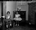 View [Two small girls wearing dresses] digital asset: [Two small girls wearing dresses]