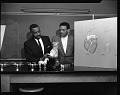 View Drs. Hawthorne and Bowie, (Grant Recipients for Heart Research), March 1964 [cellulose acetate photonegative] digital asset: Drs. Hawthorne and Bowie, (Grant Recipients for Heart Research), March 1964 [cellulose acetate photonegative].