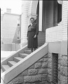 View [Mary McLeod Bethune standing on steps, front entrance to house : film photonegative] digital asset: [Mary McLeod Bethune standing on steps, front entrance to house : film photonegative, ca. 1950.]