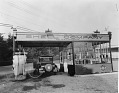 View [Shell Company of California gas station with automobile [black-and-white photoprint] digital asset: [Shell Company of California gas station with automobile [black-and-white photoprint].