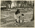 View Ryder Mobile Homes Park Collection digital asset: Woman and child at water spout