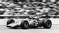 View Brawner-Ford 'Hawk' racing car digital asset: Photograph of Mario Andretti driving his Hawk toward the checkered flag in the 1969 Indianapolis 500