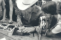 View Photographic History Collection: Henry Horenstein digital asset: Ernest Tubb (1914-1984), man signing autographs, photographs and record album.