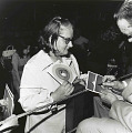 View Photographic History Collection: Henry Horenstein digital asset: A Tex Ritter fan holds a 45 RPM record as Ritter signs a photograph.