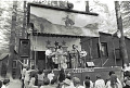 View Photographic History Collection: Henry Horenstein digital asset: Fans gather around the stage to hear the husband and wife team of Carl and Pearl Butler at the Lone Star Ranch Music Park.