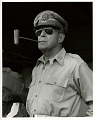 View Photographic History Collection: Carl Mydans digital asset: General Douglas MacArthur, standing with sunglasses and a pipe