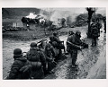 View Photographic History Collection: Carl Mydans digital asset: US Marines pass burning Korean village