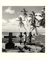 View Photographic History Collection: Carl Mydans digital asset: Bikini Island: Children walking near a tombstone