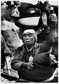 View Photographic History Collection: Carl Mydans digital asset: A Korean mother carrying her baby and worldly goods flees Seoul