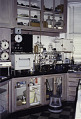View Amino Acid Analyzer digital asset: Amino acid analyzer installed at the lab bench at Rockefeller University, 1996