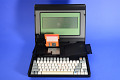 View Kaypro 2000 Microcomputer digital asset: Kaypro 2000 Microcomputer, Laptop Open with Diskette Drive and Keyboard Cable Compartment Open.